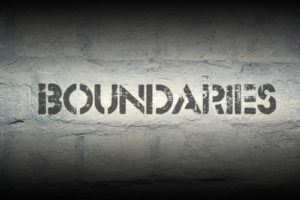 38592094 - boundaries stencil print on the grunge white brick wall